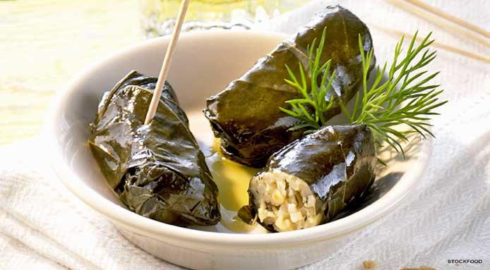 Rolls of rice wrapped in Vine leaves (Dolmadakia), served with Greek yogurt