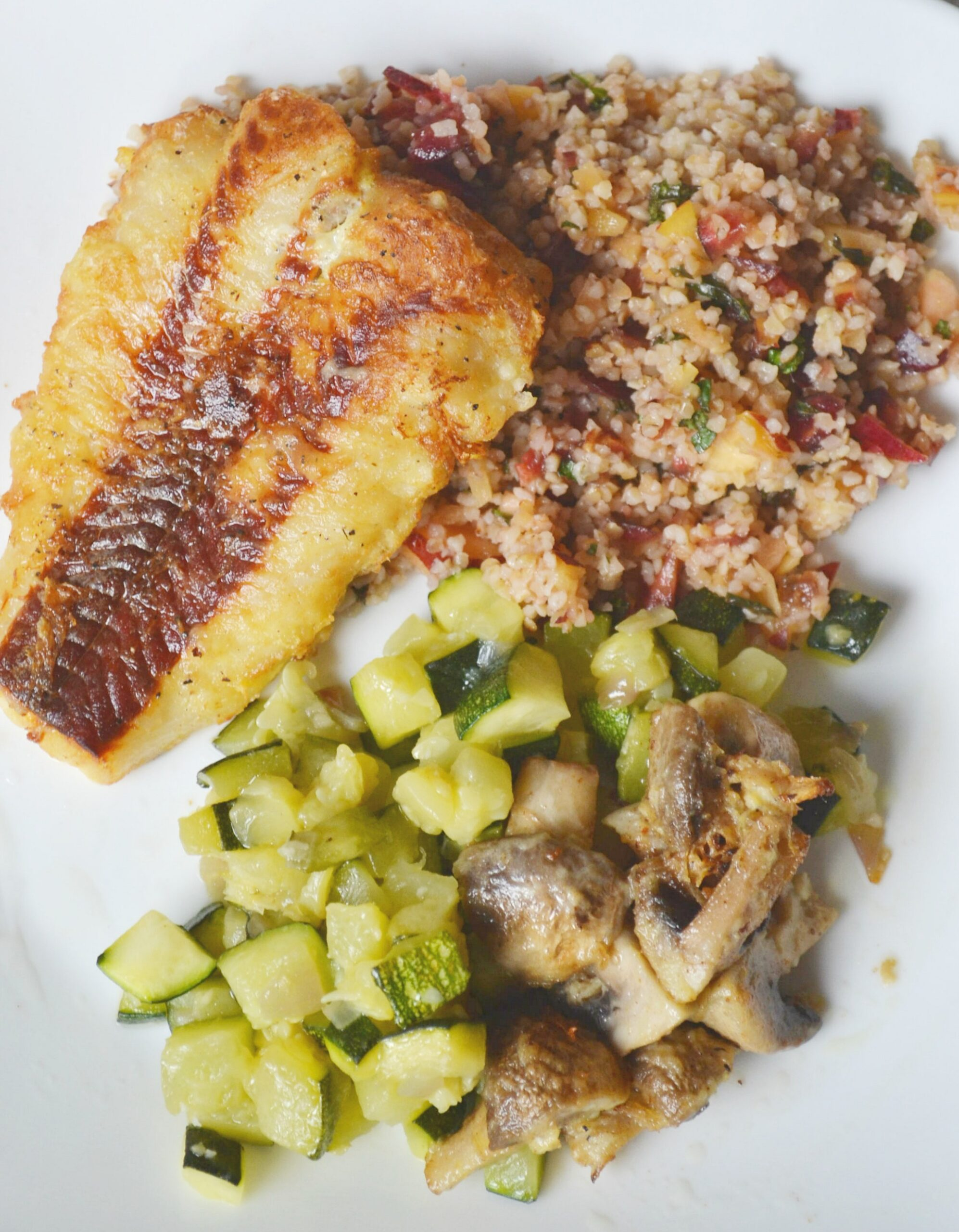 Fresh Fish sided with a bulgur tabbouleh salad