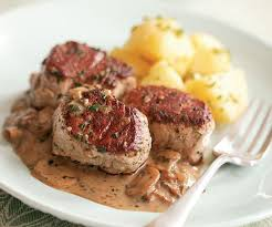 Pork tenderloin medallions in vinsanto sweet sauce with mushrooms and pine nuts