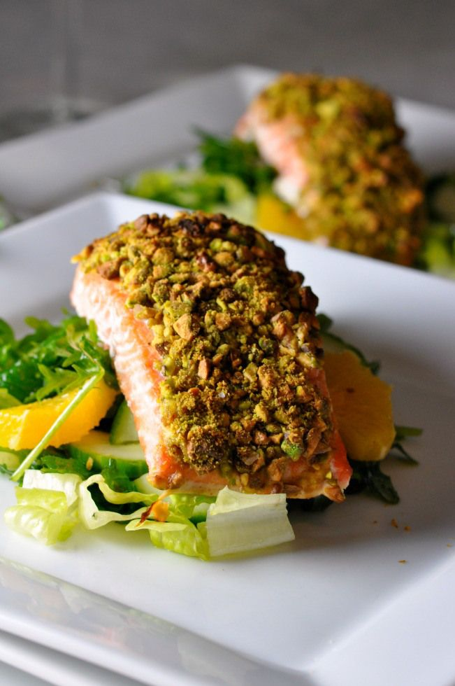 Roast salmon fillet topped with pistachios and parmesan flakes